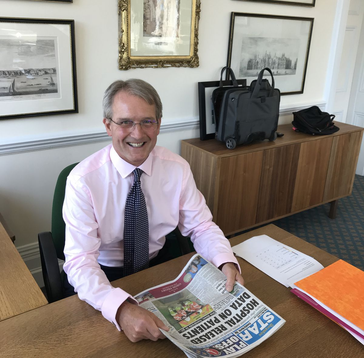 Owen Paterson is glad to be back catching up with the news behind his desk in Westminster