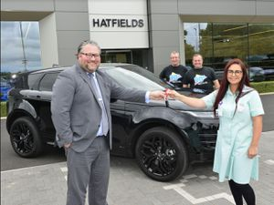 Oliver Benbow hands over the Evoque keys to Annaliza Bottomley, watched on by Paul Bennett and Dave Prince