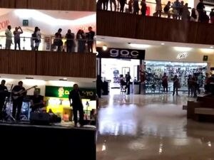 A band plays the Titanic theme music as the mall they are in floods in Mexico