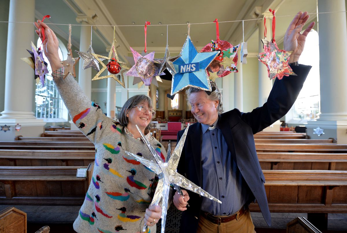 Husband and wife team Reverend Sarah and Reverend Simon Cawdell with some of the stars that have been contributed