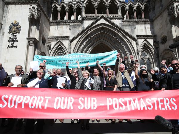 Former Post Office workers celebrate outside the Royal Courts of Justice
