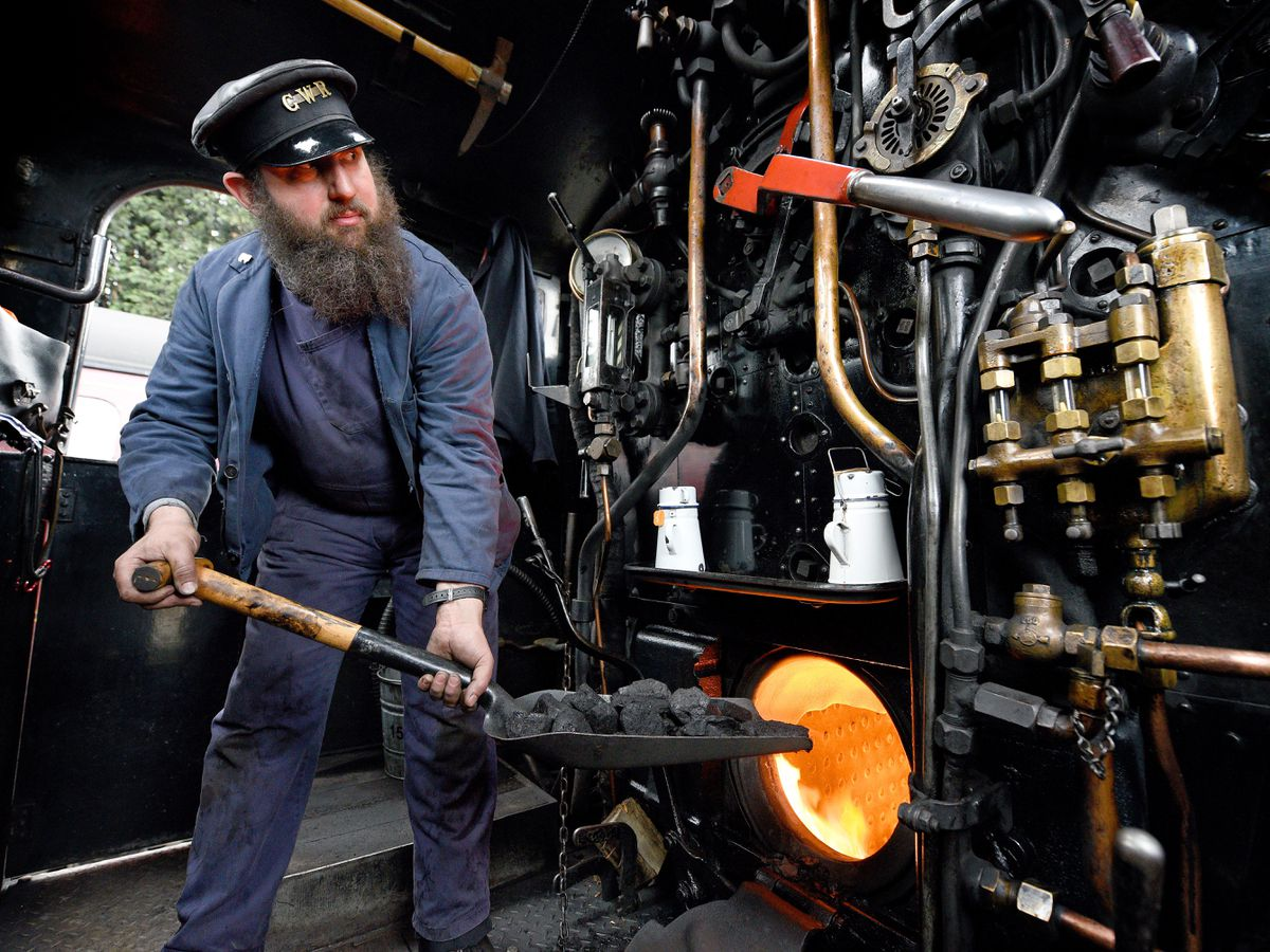 Steam Gala at Severn Valley Railway's Kidderminster Station. Tim Strevens loads the cal on the 1501 pannier tank engine