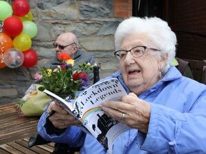 The Old Vicarage Care Home Llangollen The care home has professionally published & illustrated a book called Lockdown Legends which contains stories shared by the residents during lockdown about their lives and adventures. It was created after local storyteller Ffiona Collins began working in the home during the lockdown and encouraged the residents to share their stories. Pic : Ena Strange 99  enjoying reading  a copy of the book