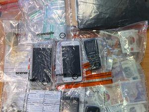 Drugs and burner phones were seized