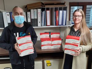 Councillor Mark Boylan with Ola Zbroszczyk of Newport Town Council and the boxes of masks
