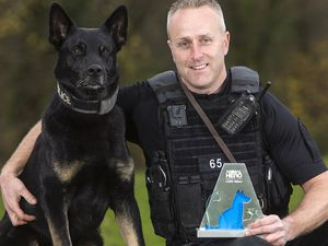 Constable Peter Lloyd and Max the dog