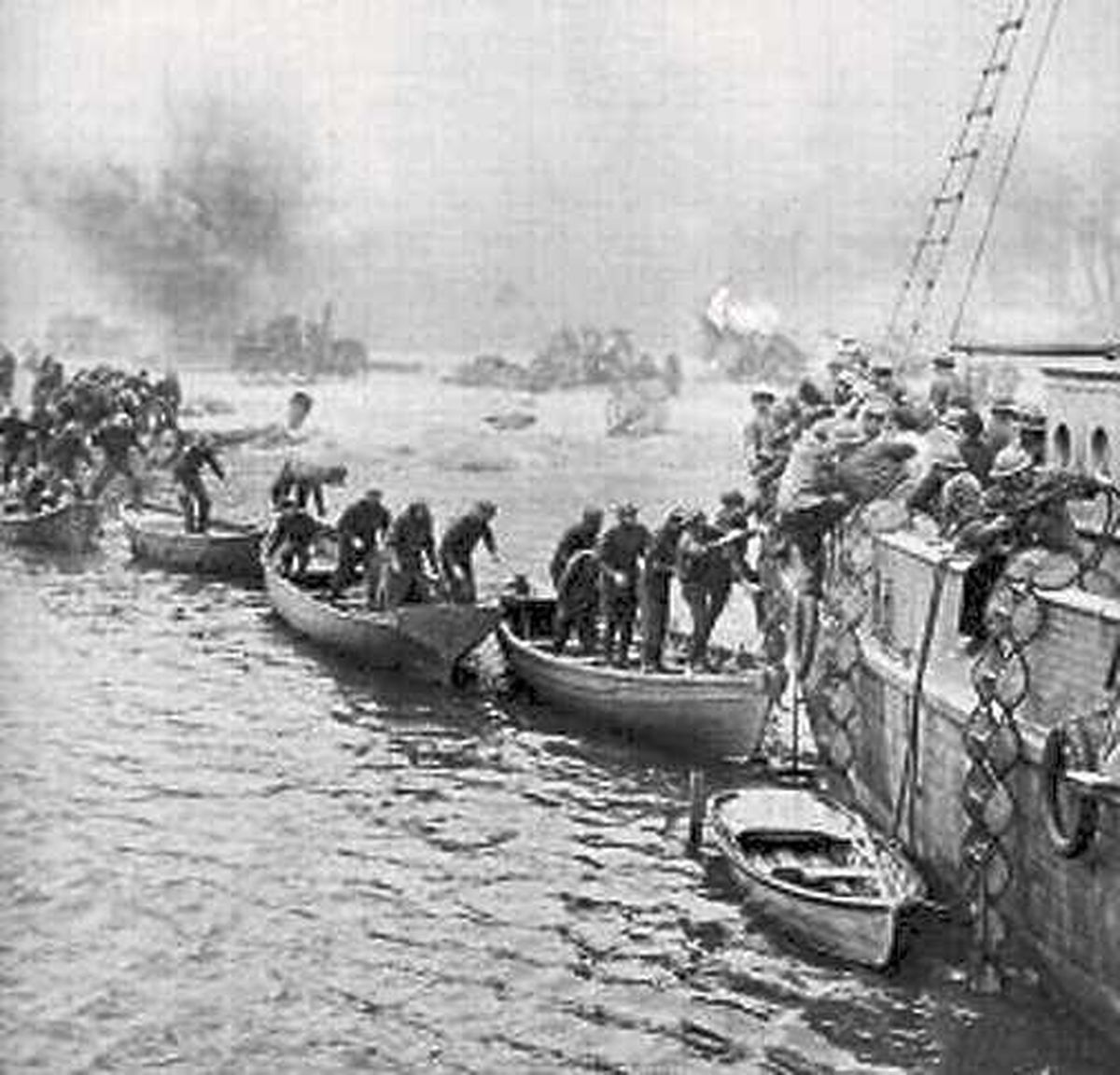 Troops seen climbing on board rescue boats during the evacuation of Dunkirk in June 1940