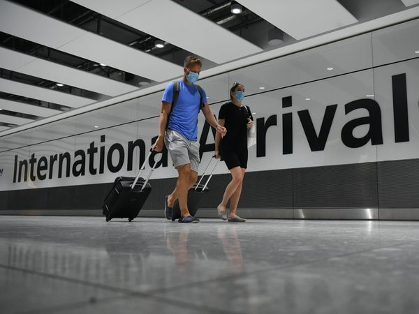 The new coronavirus lockdown causes more disruption for travellers, airlines and holiday firms (Kirsty O'Connor/PA)