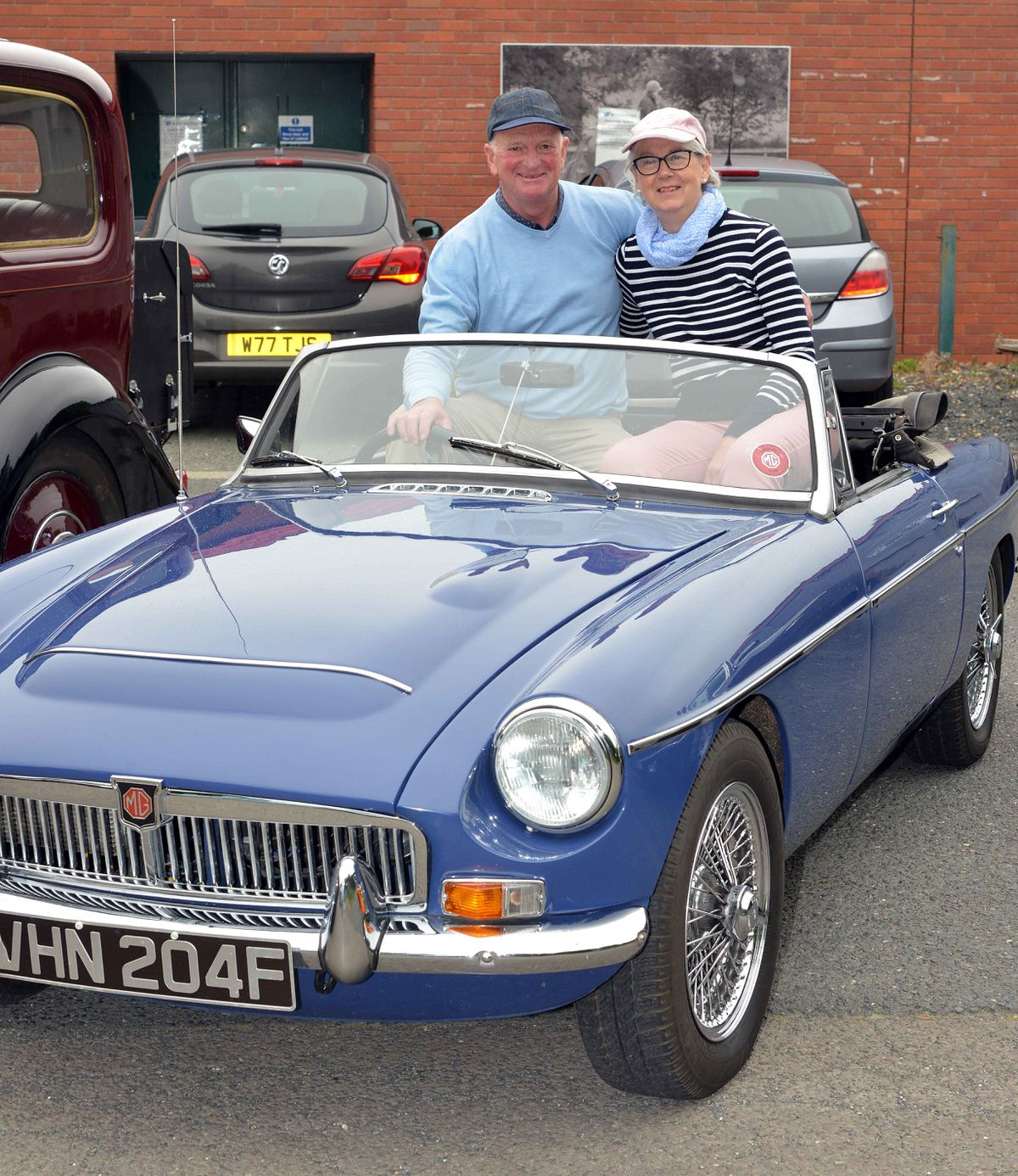 Tony and Jane Head with their 1968 MGC sports car