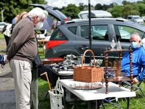 Visitors at the first antiques fair at West Midlands Showground Shrewsbury since lockdown and traders taking precaution