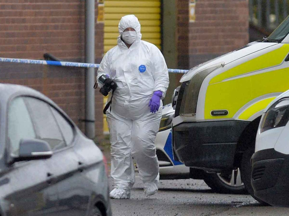 A forensics specialist at the scene in Telford where Tamba Momodu was shot