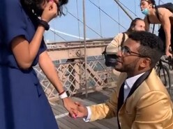 Proposal on Brooklyn Bridge interrupted after cyclist crashes into photographer