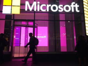 People walk past a Microsoft office in New York