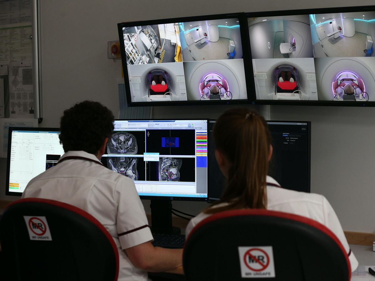 Staff monitor a patient's cancer treatment