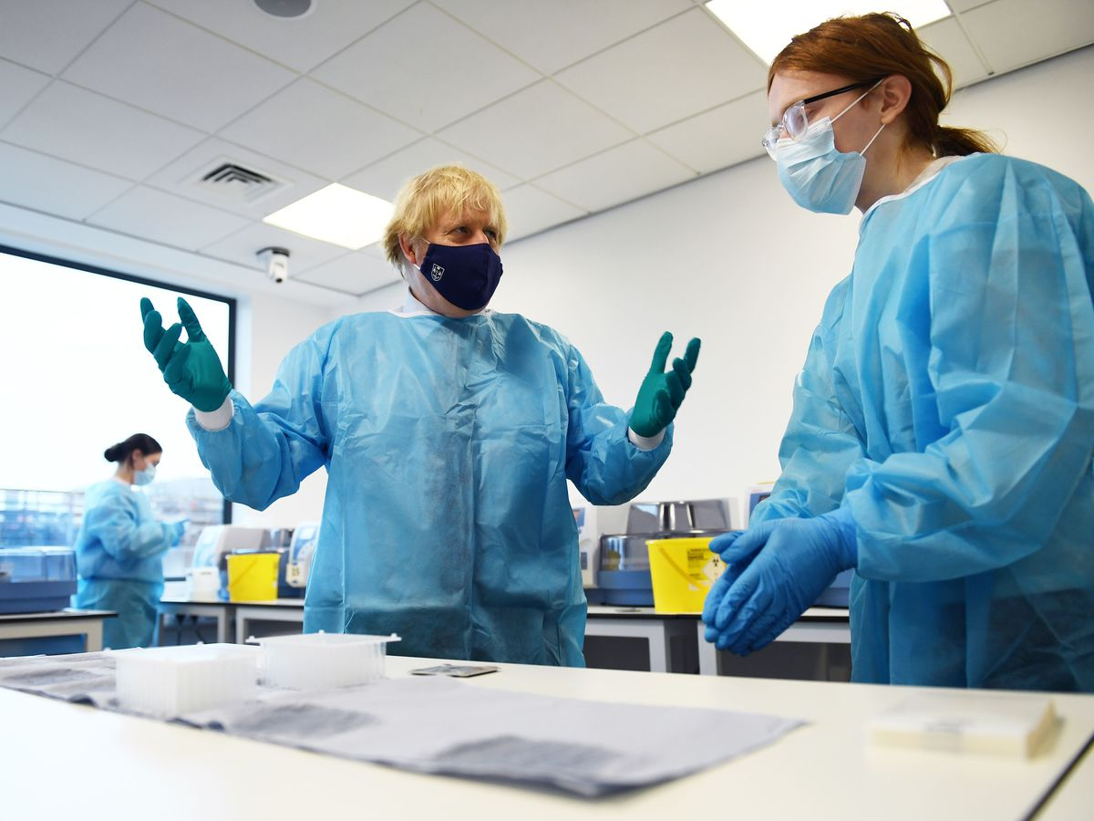 Prime Minister Boris Johnson is shown the Lighthouse Laboratory, used for processing polymerase chain reaction (PCR) samples for coronavirus, during a visit to the Queen Elizabeth University Hospital campus in Glasgow