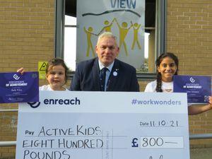 Wrekin View head teacher Adrian Pembleton with pupils Salma Mohammed (left) and Bella Riley