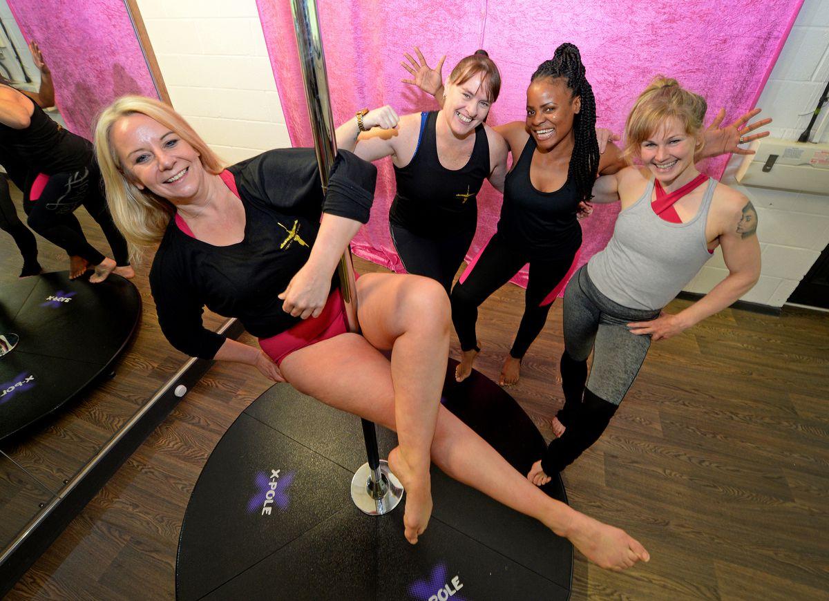 Sally Brady, owner of Liberty Pole Dance Academy, with Lisa Thomas, Sophia Thompson and Thea Wilson