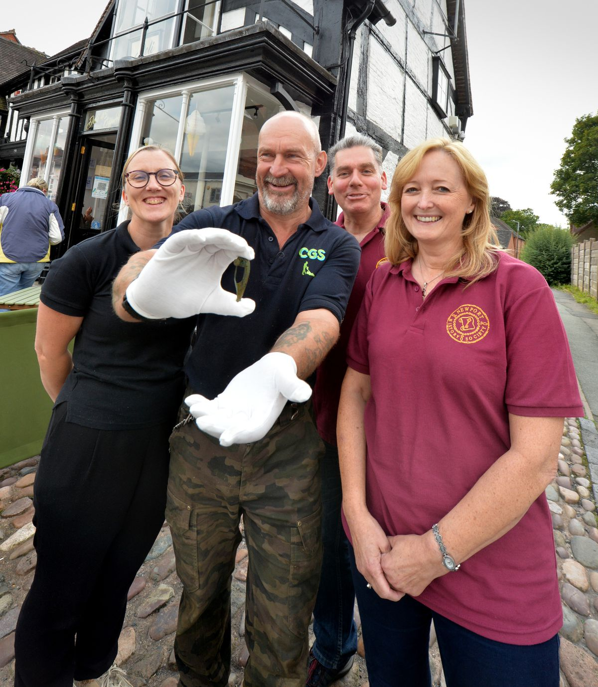 With the Roman brooch he found, Newport Society member Chris Maudsley, at Deli 45, Newport, with (left) Deli 45 owner Lisa Baker, Newport History Society field officer Julian Meeson, and member Cathryn Ross-Talbot
