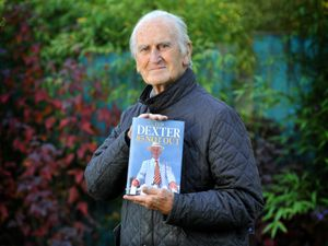 Former England cricket captain Ted Dexter with his autobiography 85 Not Out