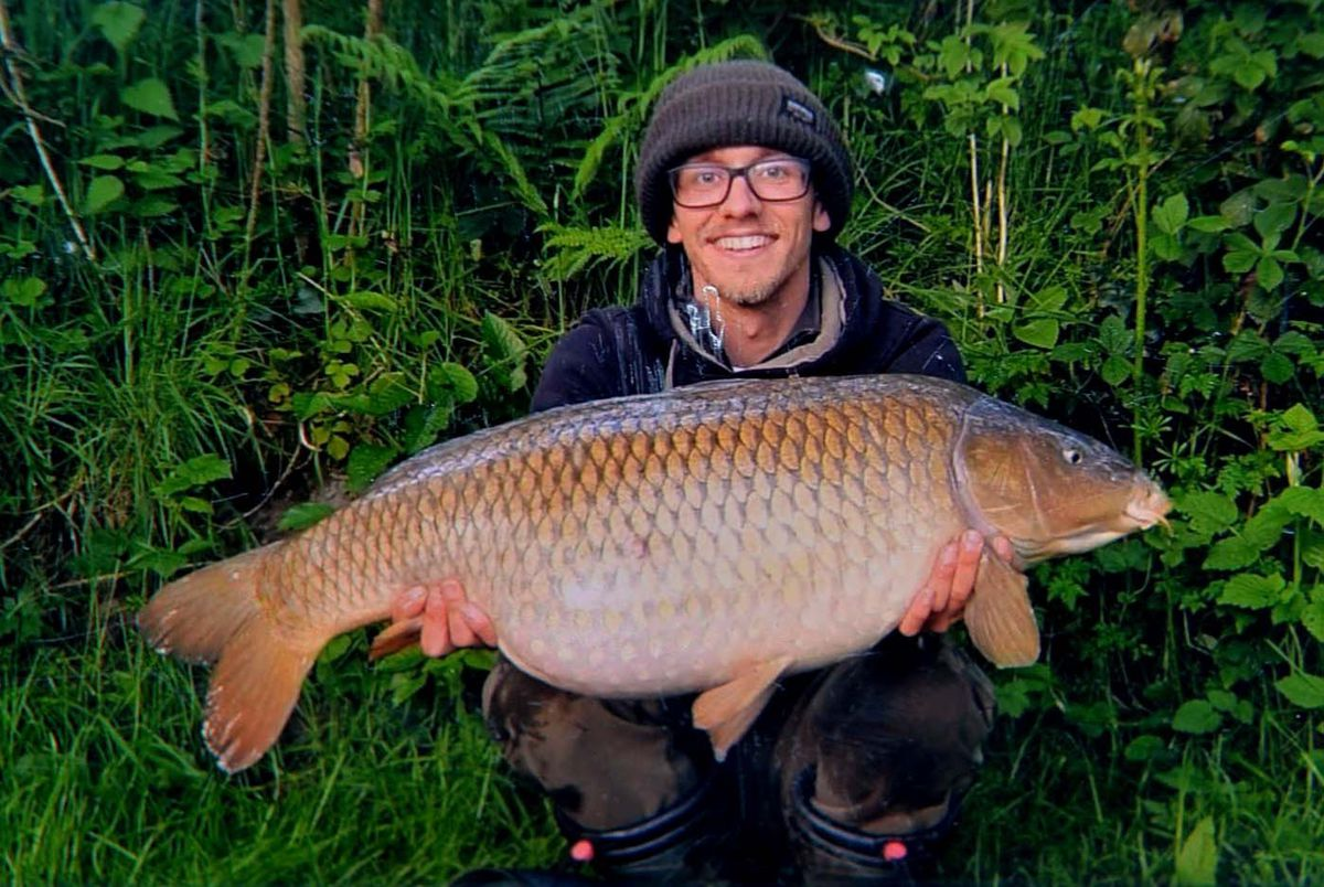 Will Bruce with a carp from the pool