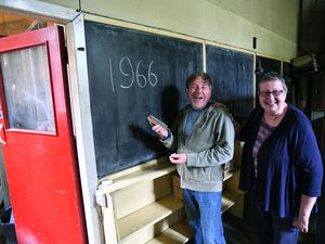 Memories of 1966. Former pupils Wayne Owen and Jean Wright at a blackboard they hadn't seen for well over 50 years. Picture: Dave Bagnall.