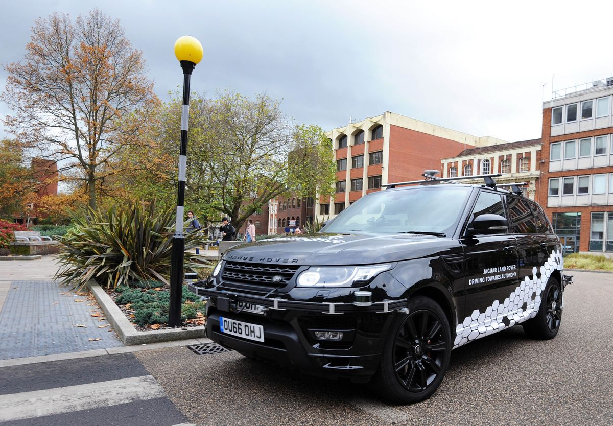 A Jaguar Land Rover research vehicle equipped with the company's self-driving technology navigates its way through Coventry city centre.