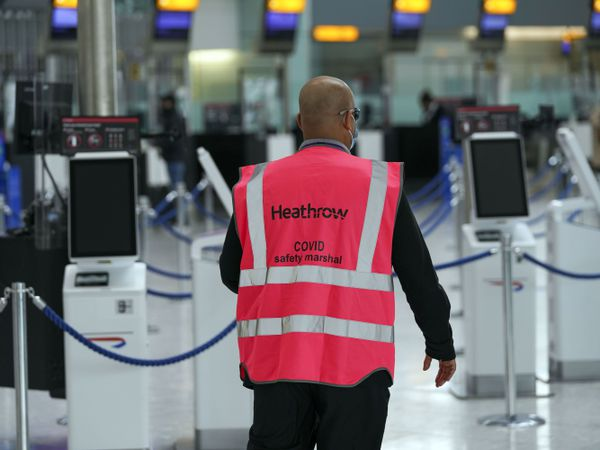 Heathrow Covid marshall patrols the airport