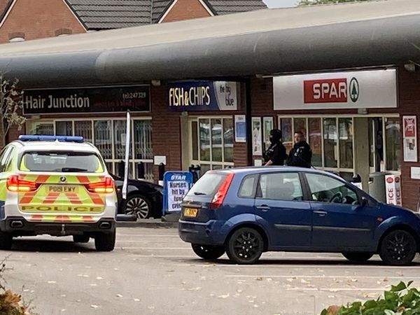 Armed police outside the Spar in Leegomery