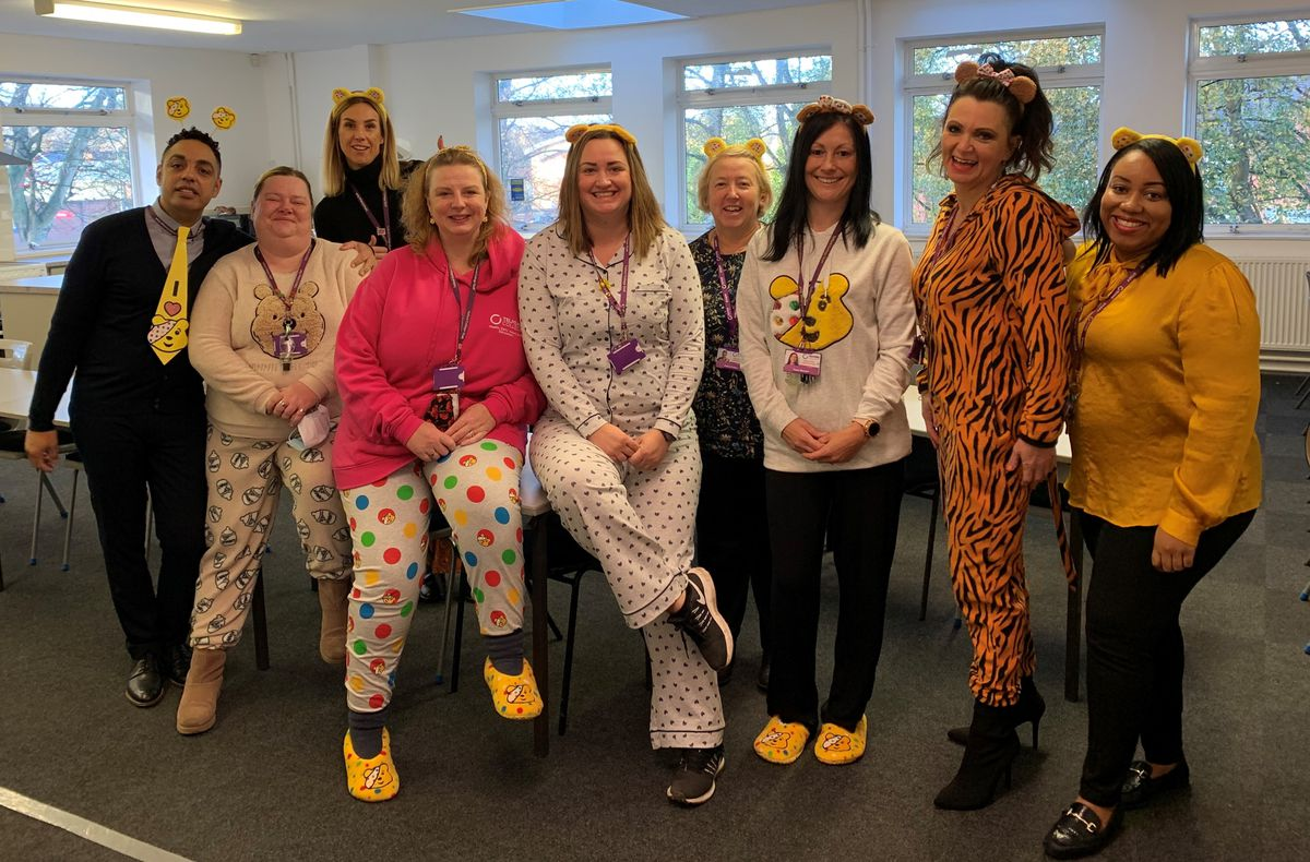 Staff at Telford College in their pyjamas
