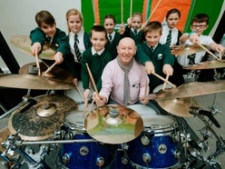 Telford pupils Rockin' all over the school with ex-Quo drummer Jeff