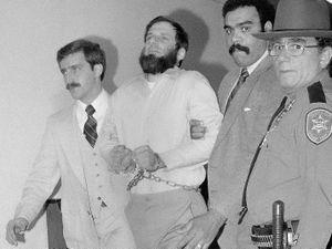 Officials escort a handcuffed David Gilbert, second from left, from Rockland County Court (David Handschuh/AP)