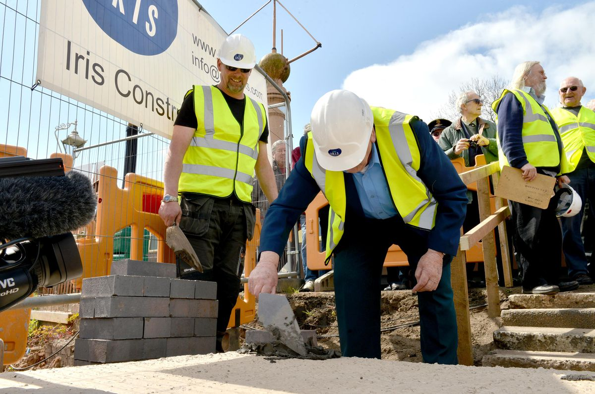 Former railway worker Barry Cook lays the first brick for the new building at Bridgnorth Severn Valley Railway Station,