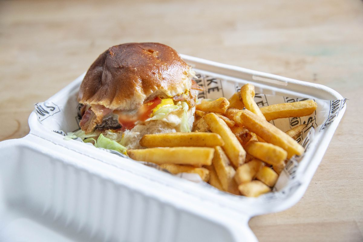 Beef burger with bacon, cheese and fries