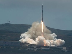 SpaceX rocket launches science and commercial satellites into space