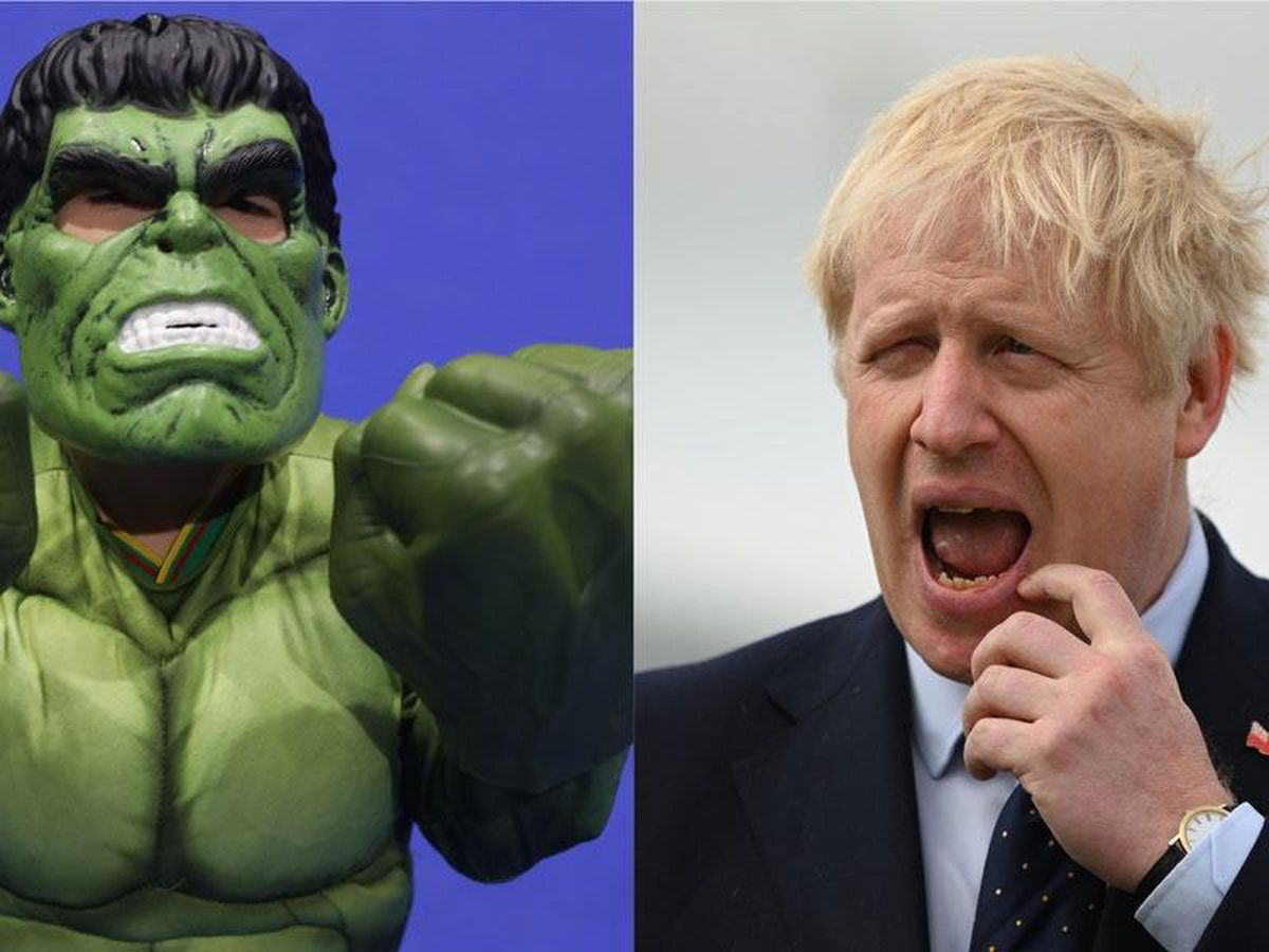 A child dressed as The Incredible Hulk and Boris Johnson