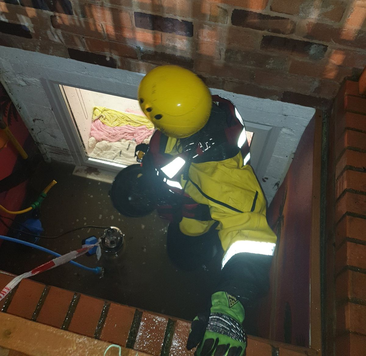 Firefighters help rescue residents in Cound during Storm Dennis. Photo: Much Wenlock Fire Station