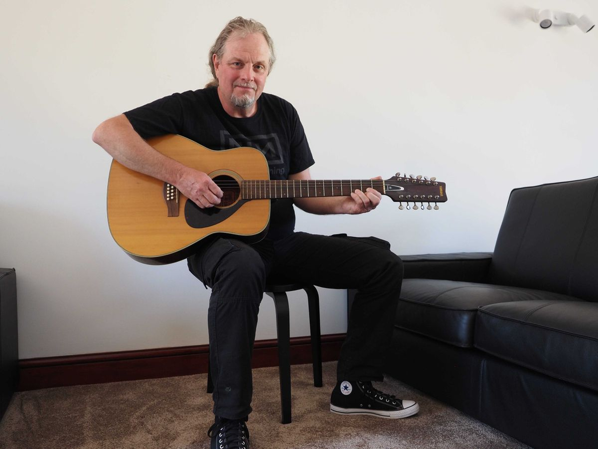 Syd Barrett's nephew, Mark Barrett, with his late uncle's 12-string Yamaha acoustic guitar