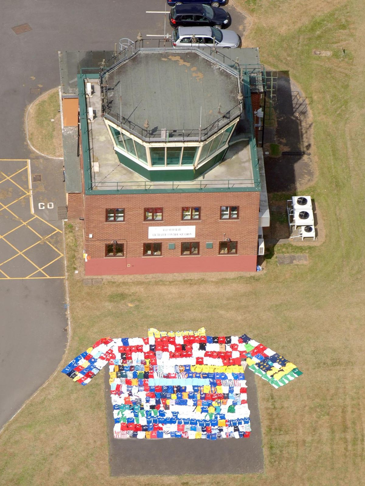 An aerial view of some of the football shirts outside the air traffic control tower at RAF Shawbury, Shropshire. Picture: Iain Thompson
