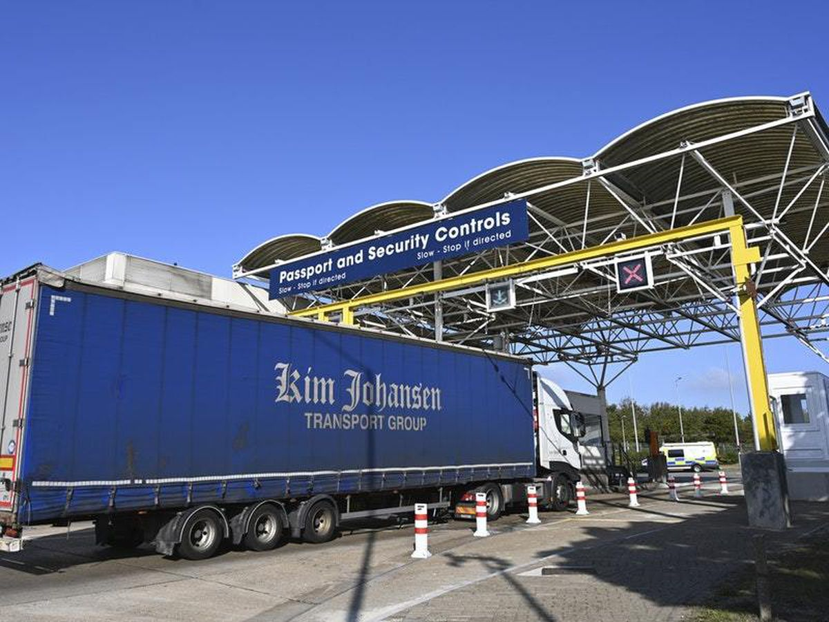 A lorry on its way to France waits to be checked by employees of Eurotunnel in Folkestone