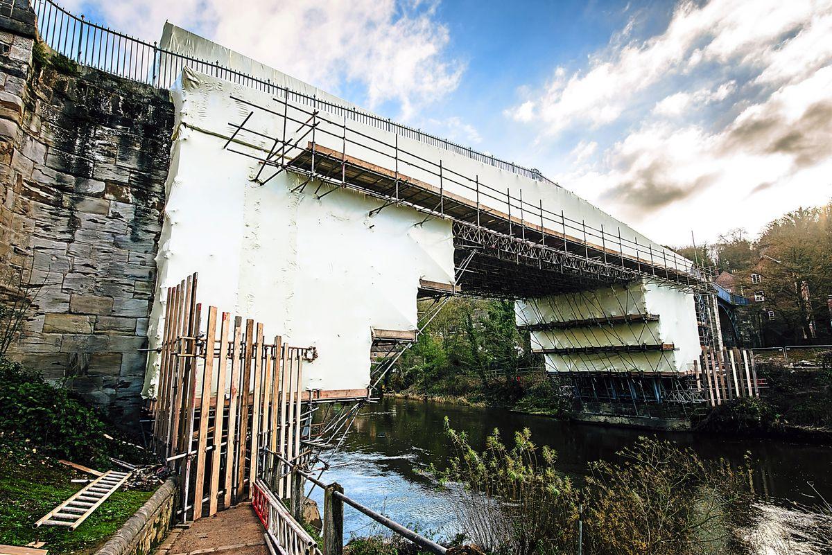 The Iron Bridge is currently hidden beneath plastic sheeting