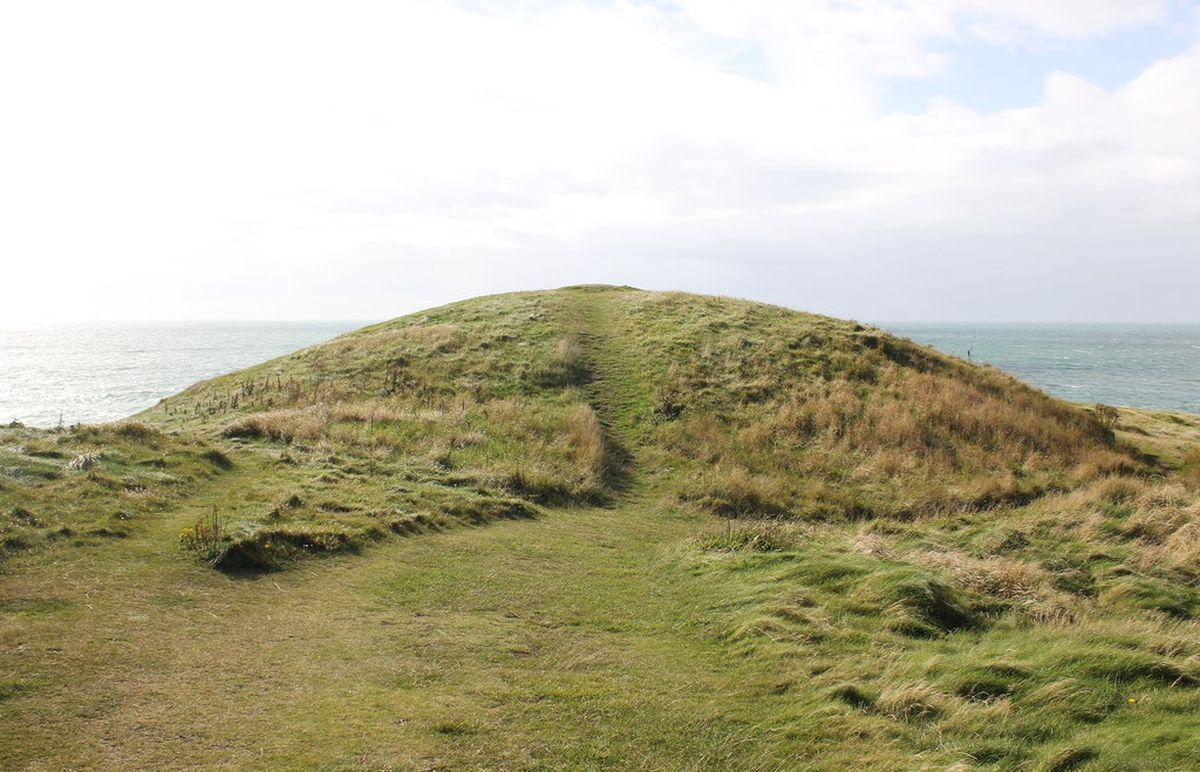 Barclodiad Y Gawres burial chamber on the coast between Aberffraw and Rhosneigr on Ynys Mon