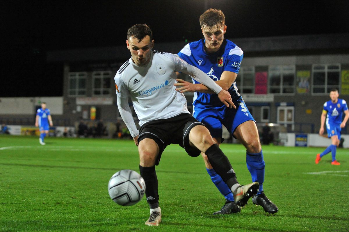 Jordan Davies of Telford battles for the ball with Harvey Smith