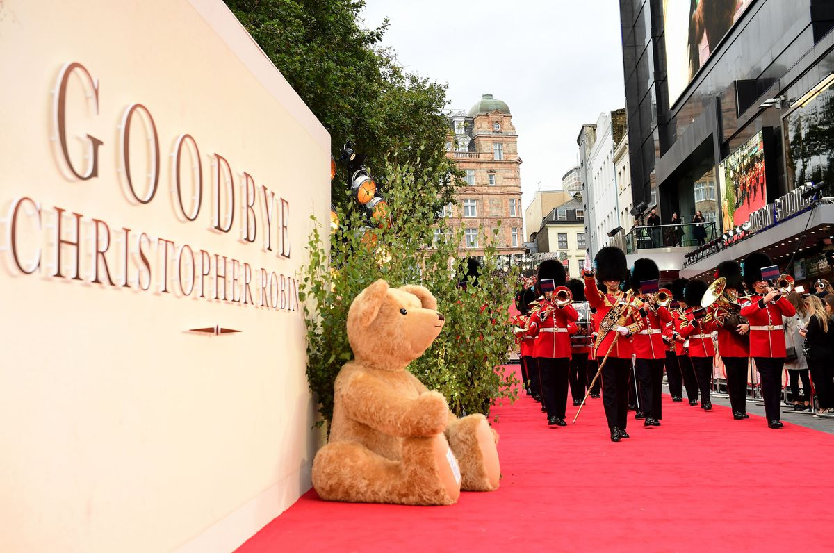 The Coldstream Guard brass band march past one of Merrythought's giant teddy bears