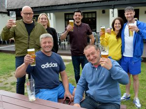 Regulars raise a glass at The Wild Pig in Shrewsbury
