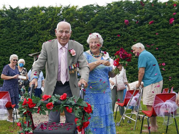 Couple in their 90s walk down the aisle after renewing their wedding blessings.