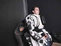 Hi-tech robot at Russian show turns out to be man in costume