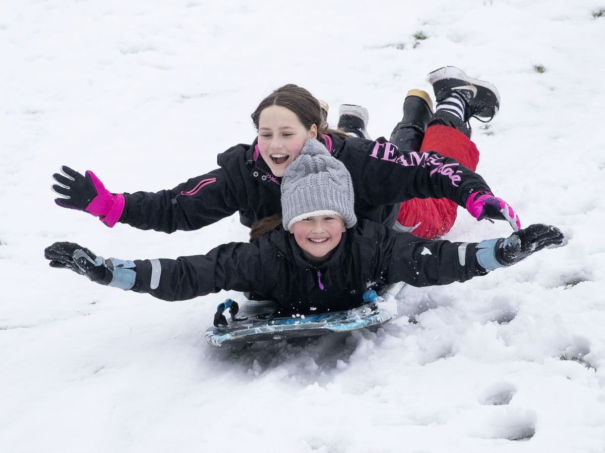 Eliza Riba-Segues, 12, left, and Laiya Grant, 11, from Penicuik, sledge at Glencourse Golf Course near Penicuik, Midlothian