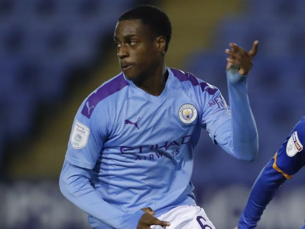 Nathanaerl Ogbeta of Manchester City and Ryan Giles of Shrewsbury Town.
