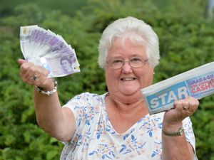 Joyce Ashley, of Pulverbatch, near Shrewsbury, celebrates winning the Shrosphire Star's Grab a Grand competition