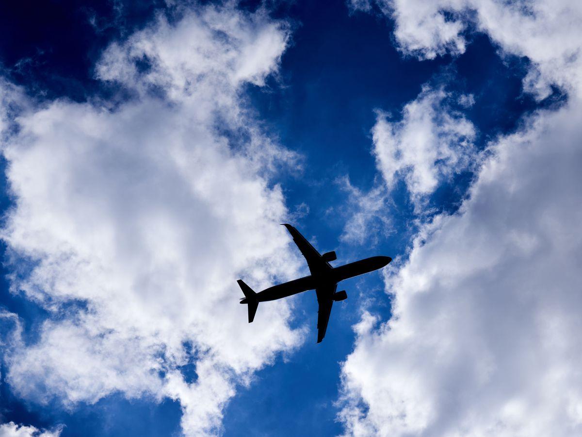 Plane flies in sky